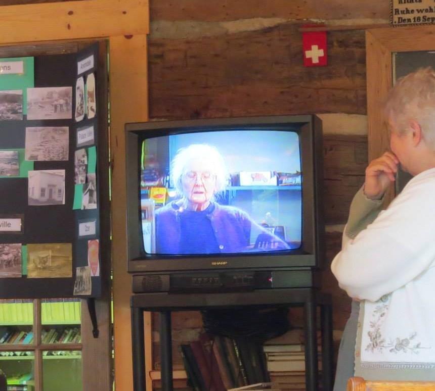Woman watching elder woman on tv